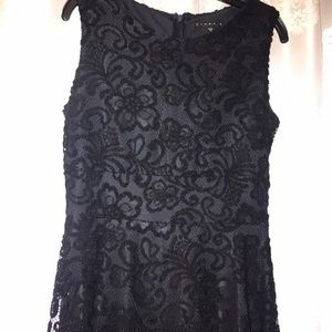 Sleeveless dress with lace overlay